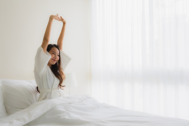 Portrait beautiful young asian women smile happy on bed Free Photo