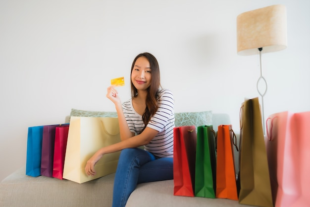 Portrait beautiful young asian women with credit card mobile phone or computer for shopping Free Photo