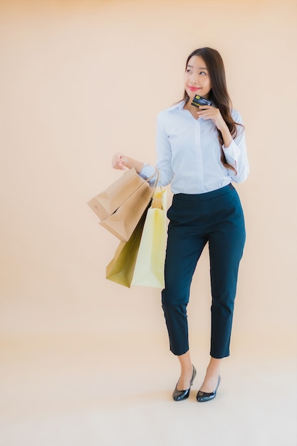 Portrait beautiful young business asian woman with a lot of shopping bag from retails and department store Free Photo