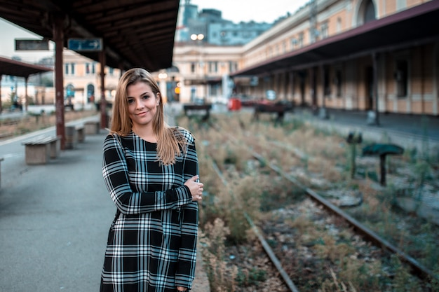 Portrait of a beautiful young girl on the train station Premium Photo