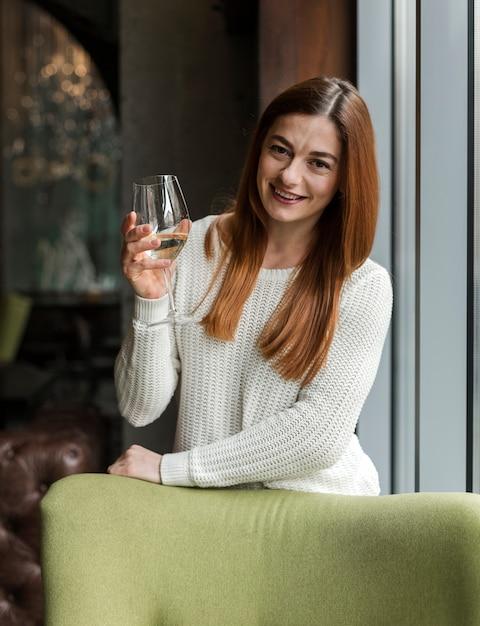 Portrait of beautiful young woman having wine Free Photo