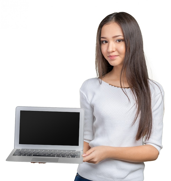 Portrait of beautiful young woman holding laptop isolated Premium Photo