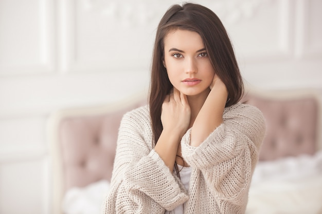 Portrait of beautiful young woman indoors. pretty girl close up portrait Premium Photo