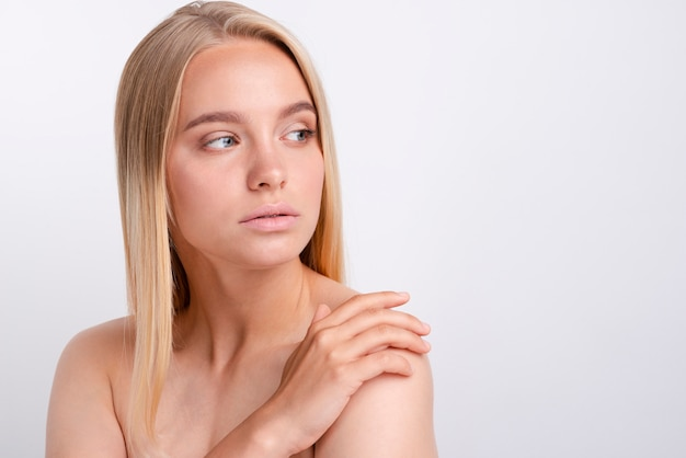 Portrait of beautiful young  woman looking away Free Photo