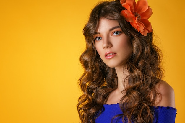 Portrait of a beautiful young woman on a yellow background, Premium Photo