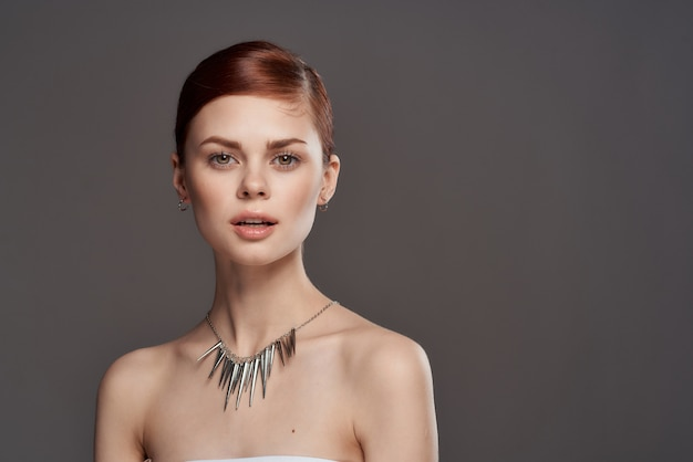 Portrait of a beauty young woman, clean skin, advertisement of jewelry, earrings, rings, chains, Premium Photo