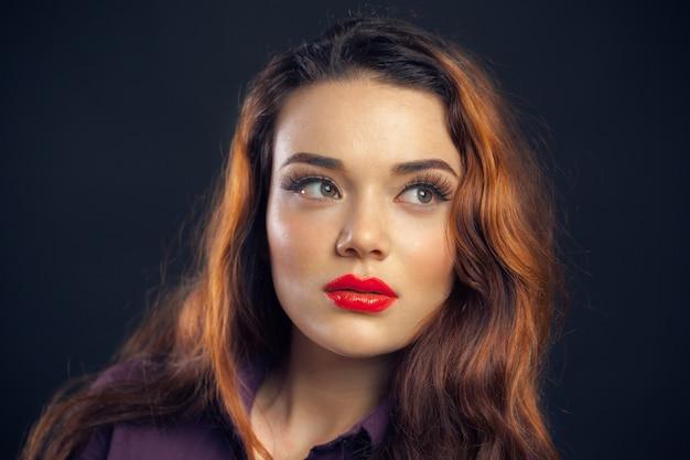 Portrait of beutiful girl isolated on dark background Premium Photo