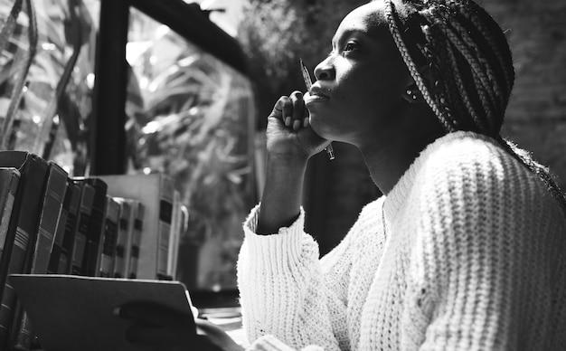 Portrait of black woman with dreadlocks hair Free Photo