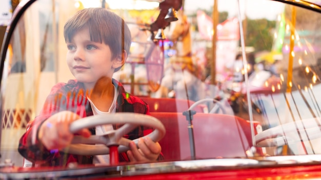 Portrait boy in amusement park Free Photo