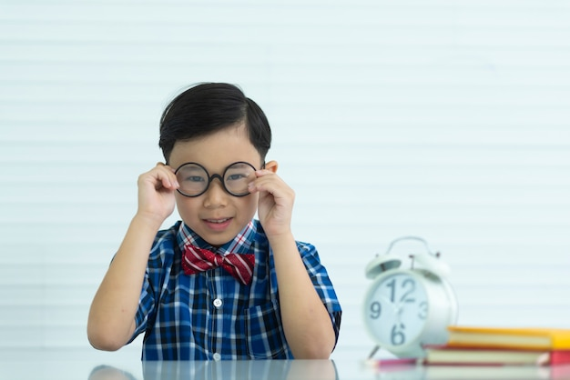 Portrait of a boy in classroom Premium Photo