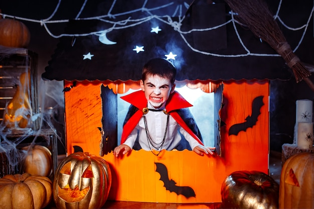 Portrait of a boy dressed in a costume of a vampire Premium Photo