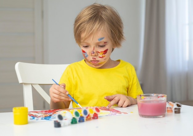 Portrait boy painting Free Photo