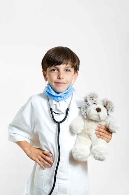 Portrait of boy with teddy bear Free Photo