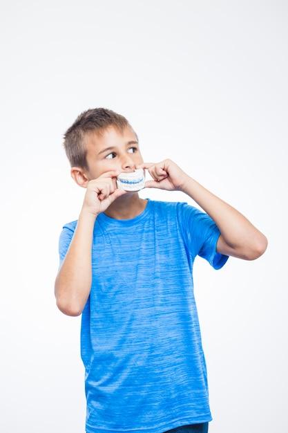 Portrait of a boy with teeth model Free Photo