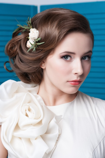 Portrait of the bride with big beautiful eyes on blue Premium Photo