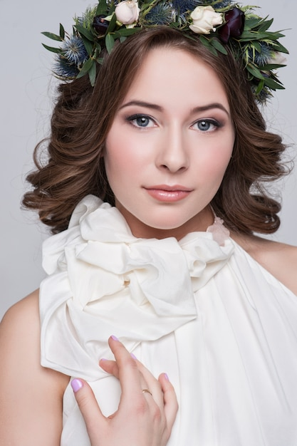 Portrait of the bride with big beautiful eyes on white Premium Photo