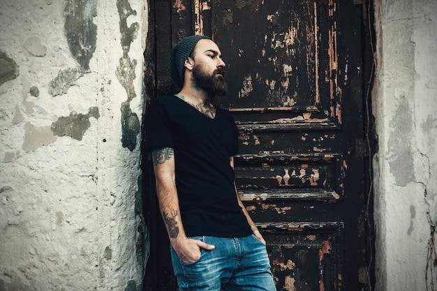 Portrait of brutal bearded man wearing blank t-shirt Premium Photo
