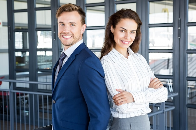 Portrait of businessman and businesswoman smiling in office Premium Photo
