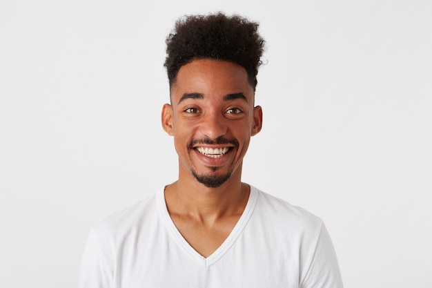 Portrait of cheerful attractive african american young man Free Photo
