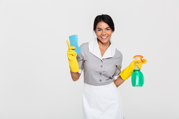 Portrait of a cheerful attractive housekeeper Free Photo