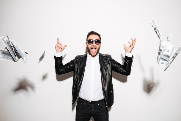 Portrait of a cheerful bearded man celebrating success Free Photo