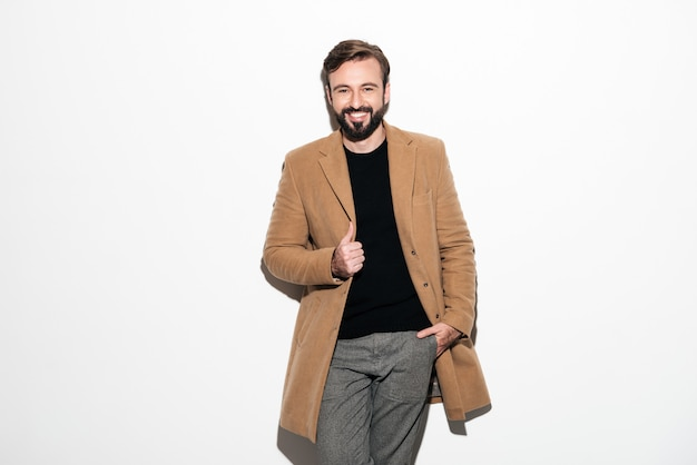 Portrait of a cheerful bearded man dressed in a coat Free Photo