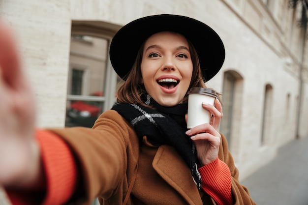 Portrait of a cheerful girl dressed in autumn clothes Free Photo