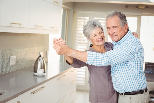 Portrait of cheerful senior man dancing with his wife Premium Photo