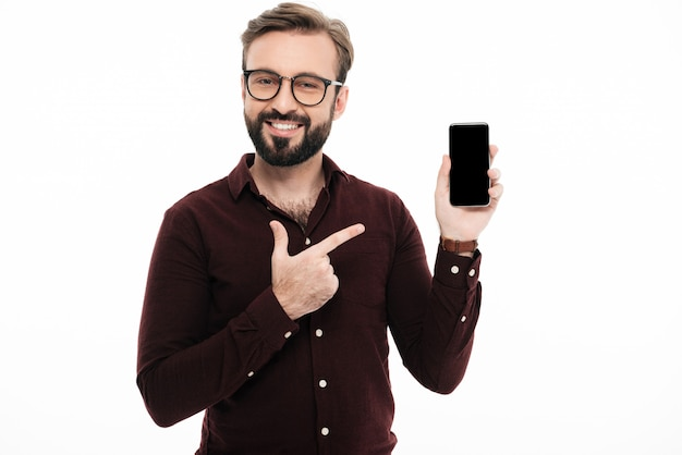 Portrait of a cheerful smiling man pointing Free Photo
