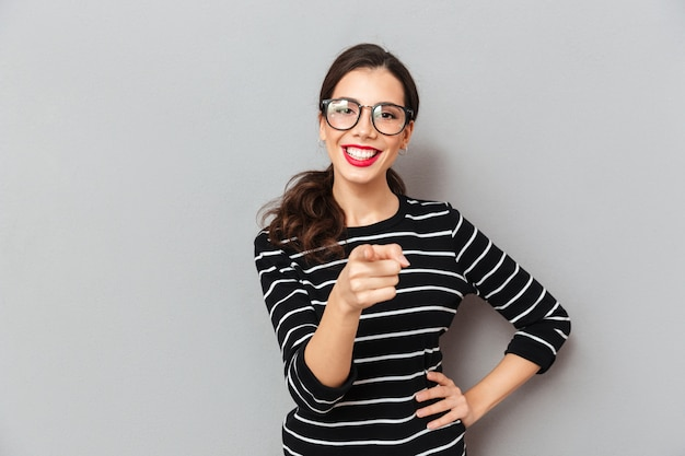 Portrait of a cheerful woman in eyeglasses Free Photo