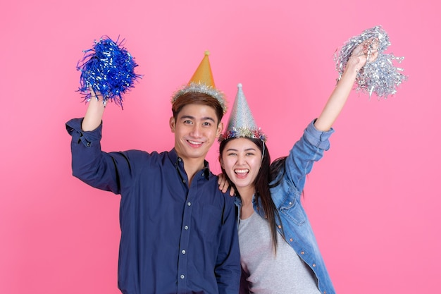 Portrait cheerful young couple with party prop Free Photo