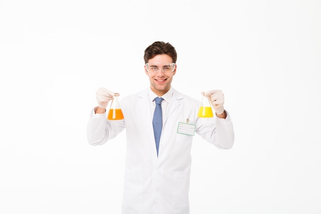 Portrait of a cheerful young male scientist Free Photo