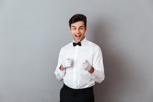 Portrait of a cheerful young male waiter Free Photo