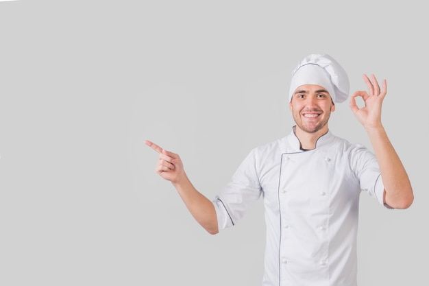 Portrait of chef doing tasty gesture Free Photo