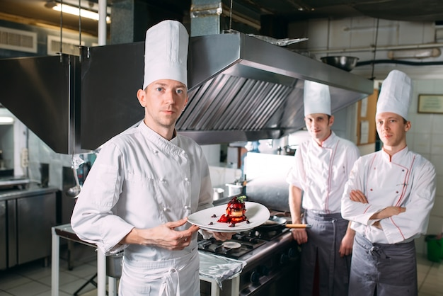 Premium Photo Portrait Of The Chef In The Kitchen Of The Restaurant With A Ready Made Dish Foie Gras
