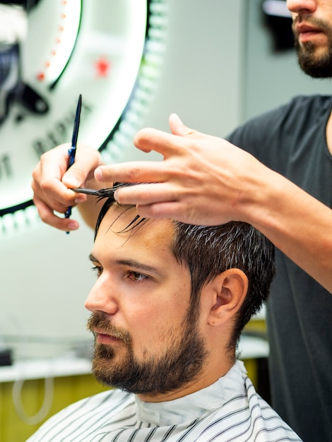 Portrait of client getting a haircut Free Photo