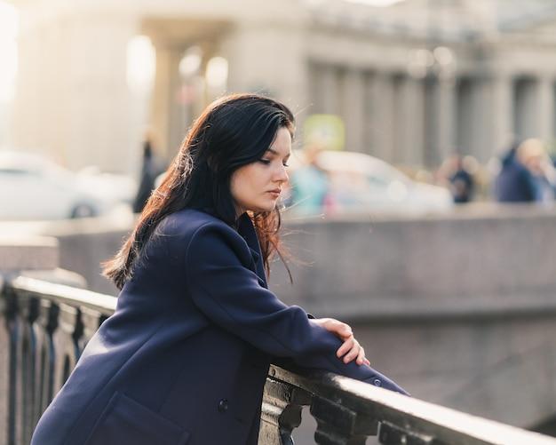 Portrait close-up of beautiful intelligent brunette who walks down street Premium Photo