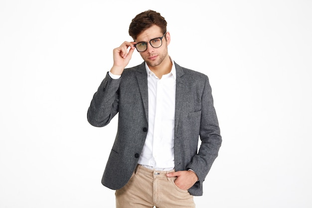 Portrait of a confident business man in a jacket Free Photo