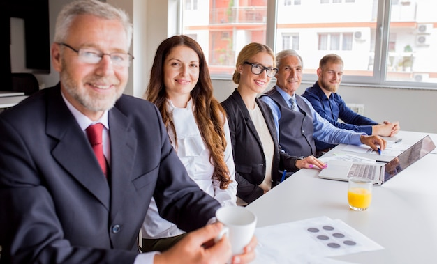 Portrait of confident business team working in the office Free Photo