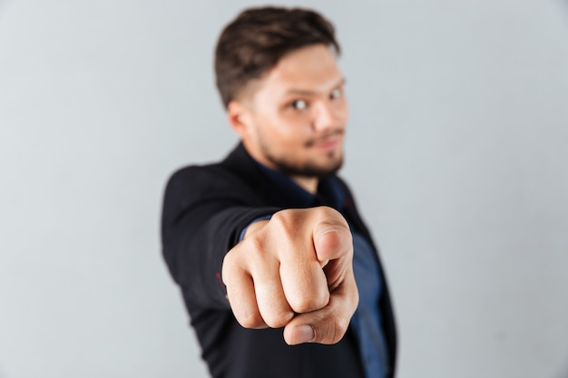 Portrait of a confident businessman pointing Free Photo