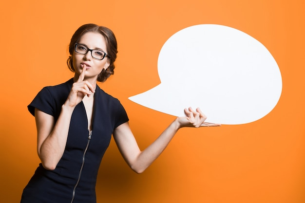 Portrait of confident excited beautiful young business woman with speech bubble in her hands Premium Photo