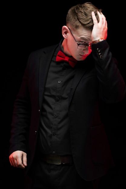 Portrait of confident handsome elegant responsible businessman thinking holding hand on his head Premium Photo