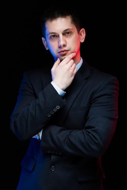 Portrait of confident handsome stylish businessman touching his chin Premium Photo