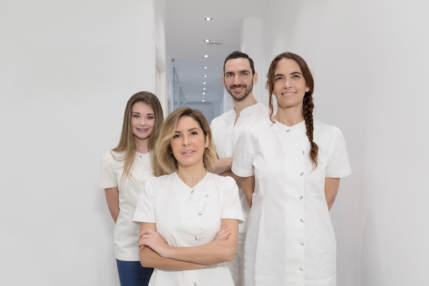 Portrait of confident happy group of doctors standing at the medical office Premium Photo