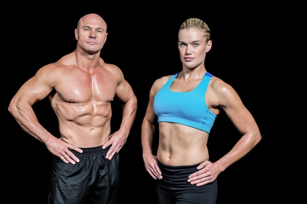 Portrait of confident man and woman with hands on hip Premium Photo