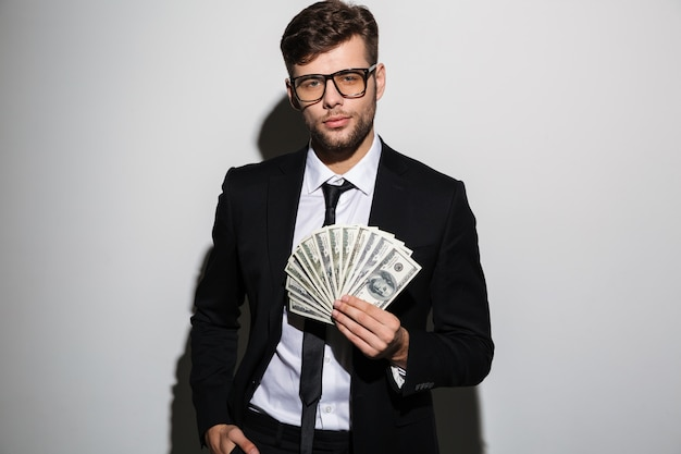 Portrait of a confident successful man in suit and eyewear Free Photo