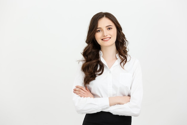 Portrait confident young businesswoman keeping arms crossed and looking at camera Premium Photo