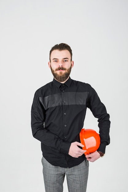 Portrait of confident young male engineer against white backdrop Free Photo