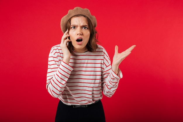 Portrait of a confused woman wearing beret Free Photo