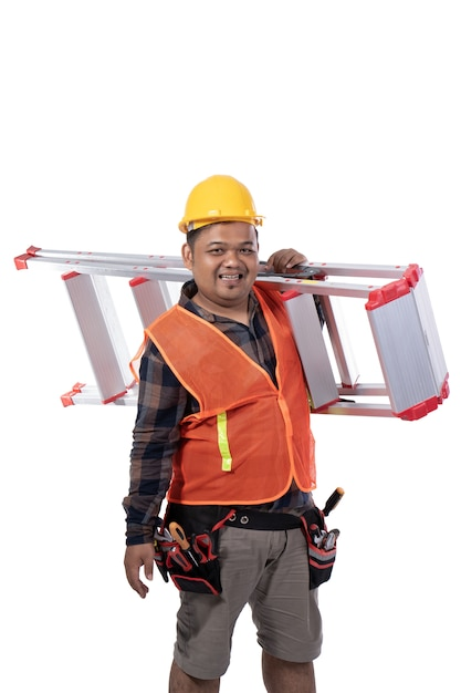 Portrait of constructor carrying stairs with helmet and uniform Premium Photo